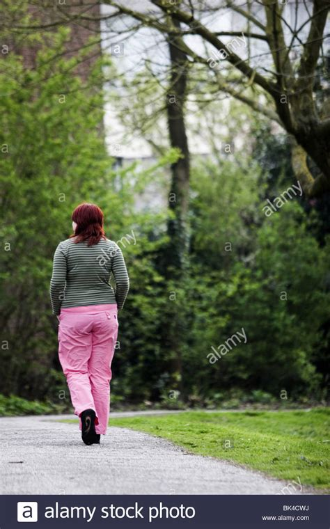 summer for obese people back view young obese woman walk off the weight in summer
