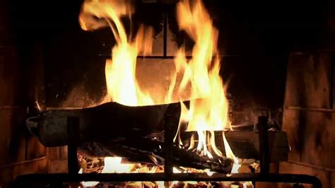 beautiful wood burning fireplace yule log