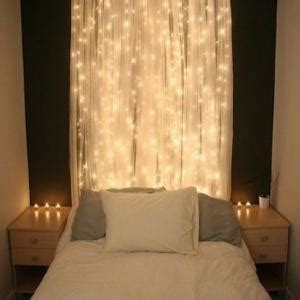 how to hang string curtains hang a curtain a bed and string lights
