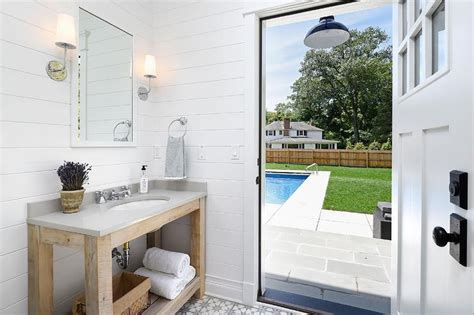 pool house with bathroom reclaimed wood vanity with gray quartz countertop