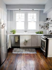 Floor Cabinets For Kitchen White Kitchen Cabinets Subway Tile Stainless Steel Appliances Blue Walls Plank Wood Floors The