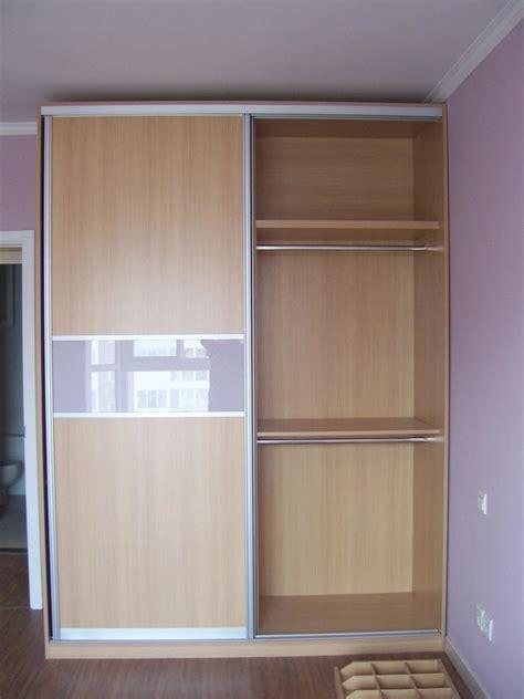 high wooden wardrobe with sliding door also shelves