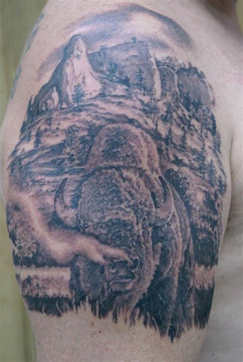 black ink buffalo tattoo  man  shoulder