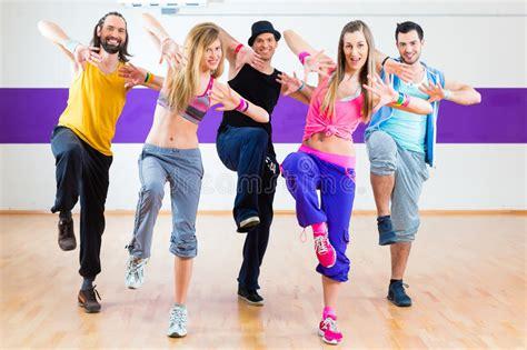 zumba exercise tutorial dancer at zumba fitness training in dance studio stock