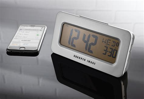 smartphone app controlled alarm clock sharper image