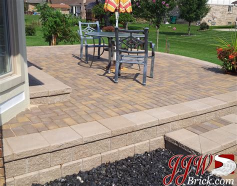 4 X 8 Patio Pavers Raised Brick Paver Patio With Unilock Pisa Ii Retaining Wall And Classic 4x8 Paver Stones