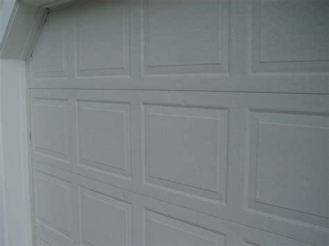 Dented Garage Door by Paint Inc 614 837 8477