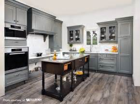 maple cabinets stained in a rich grey tone complemented