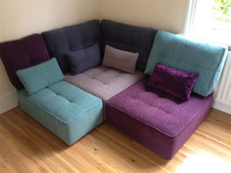 bedroom corner sofa tapas modules covered in warwick fabrics marco amethyst