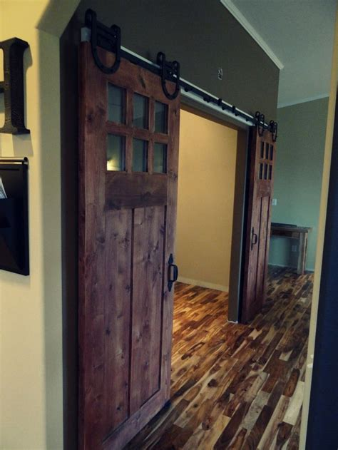 sophisticated barn doors interior with glass top