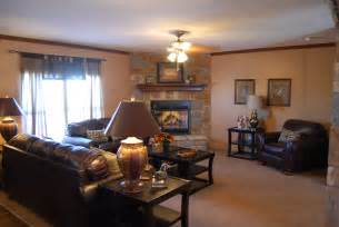 living room with corner rock fireplace home and