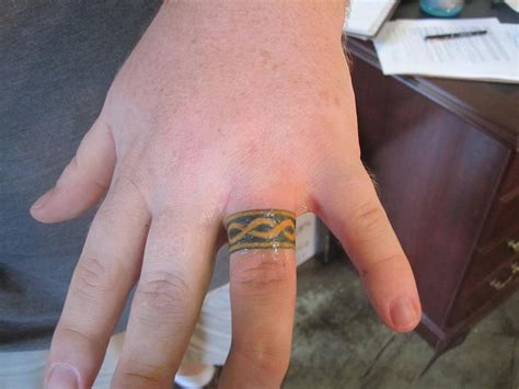 finger tattoos men designs wedding ring tattoos impressive exles on slodive