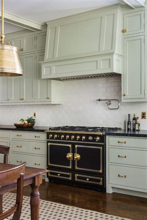 light green kitchen cabinets polar cream granite design ideas