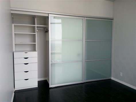 Sliding Glass Closet Doors Large Modern Closet Design With Wooden Storage Painted