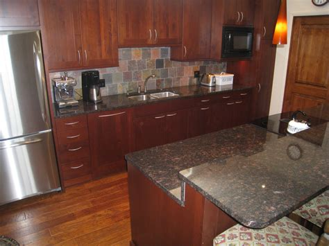 countertops for light oak cabinets extendable wood bar modern white subway tile backspalsh