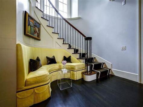 sofa under stairs yellow sofa on curved staircase wall transitional sofa