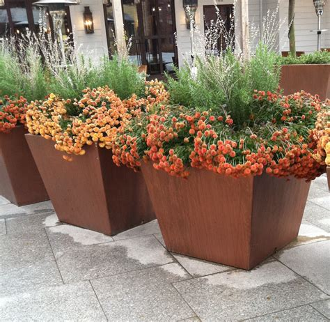 containers vs pots for your garden and landscape rock spring design group llc