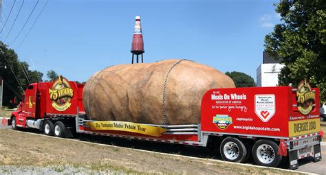 worlds largest potato rolls up next to world s largest ketchup bottle fox2now