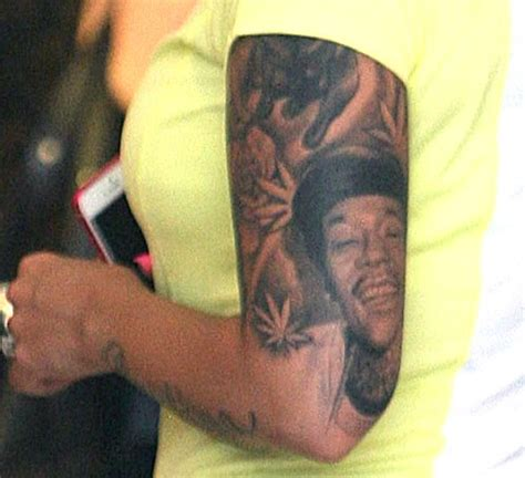 amber rose tattoo gets inked with hilarious of wiz khalifa