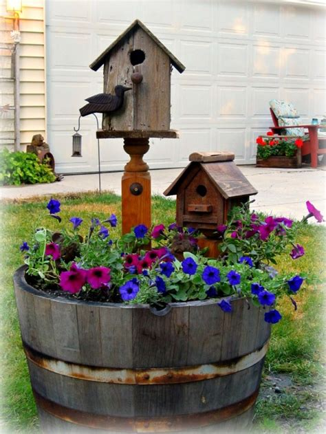 a whiskey barrel planter love the idea of having the bird