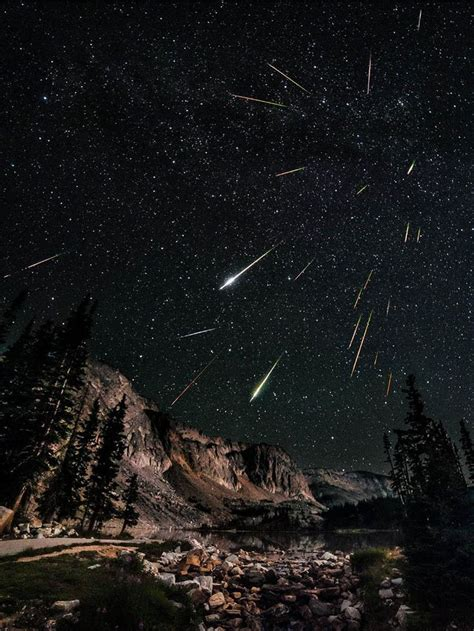 the perseids meteor shower at lake in the snowy