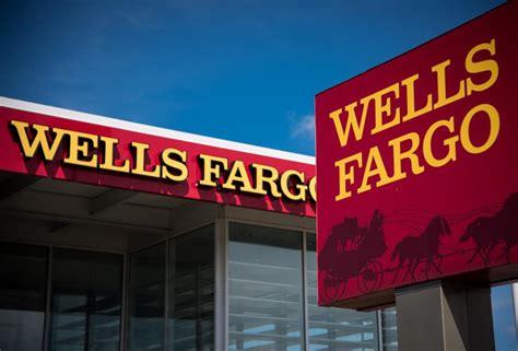wf bank fargo s misfire pushes profits below 1 a