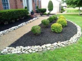 white landscaping house landscape with white rock river rock