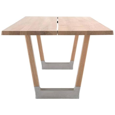 table l wood base arco base dining table in solid wood with concrete detail
