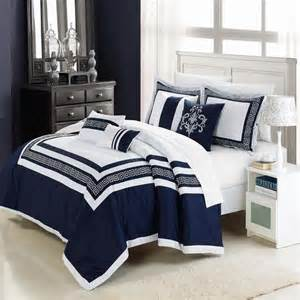 white bedding with blue accent white and navy blue