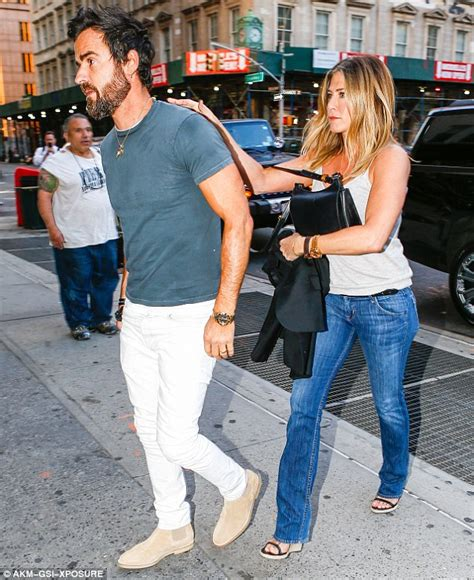 jennifer aniston and justin theroux jet off on honeymoon jennifer aniston cuddles justin theroux after sparking