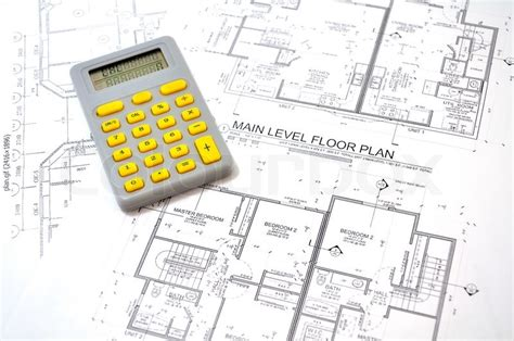 house building calculator draft plan of building a house and calculator stock