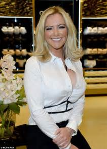 unbutton open shirt blouse cleavage michelle mone displays cleavage in unbuttoned blouse and