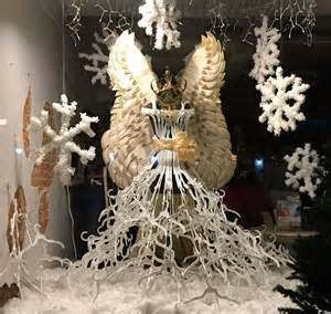 Winter Wonderland Ball Decorations - christmas window display with paper plates angel wings and white plastic hanger gown