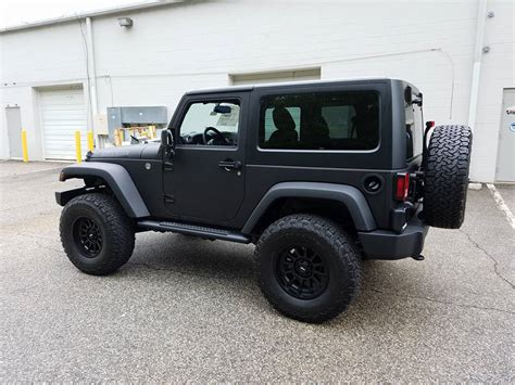 back of a jeep matte black jeep color change hawkeye graphics