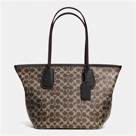 canvas zip tote coach taxi zip top tote in signature canvas in brown lyst