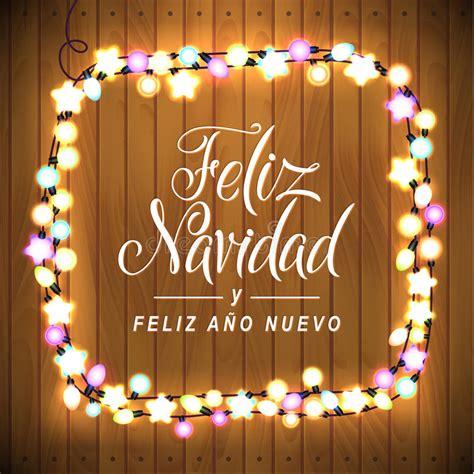 merry christmas  happy  year spanish language glowing lights wreath  xmas holiday