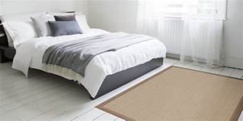Where To Place A Rug In A Bedroom by How To Place Area Rugs In Your Bedroom Hudson Flooring