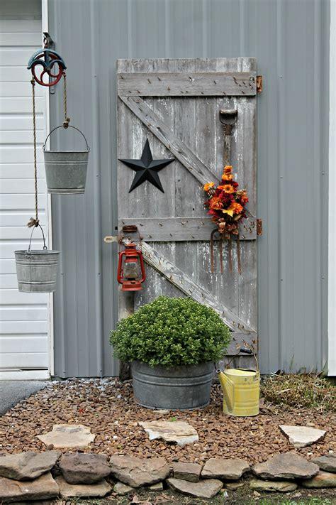antique barn door decorated  fall garden yard ideas