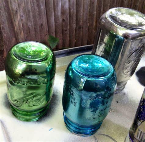 Painting Glass Jars by Diy Mirrored Jars With Krylon Looking Glass Spray