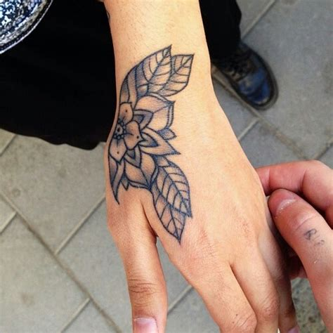 flower tattoo in hand 15 beautiful hand tattoos for both men and women pretty