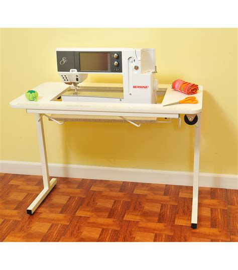 Online Shopping Sites Home Decor homespun sewing table with wheels white at joann com