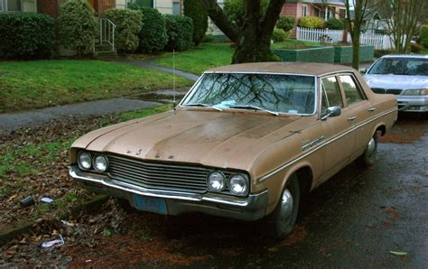 parked cars 1964 buick special sedan
