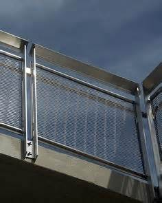 Pin Skurity Lecil contemporary stainless steel railings with glass panels made by capozzoli stairworks in pa