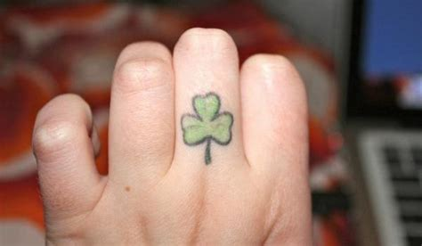 small shamrock tattoo small shamrock finger