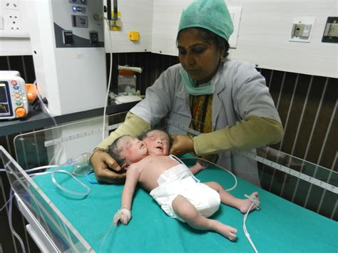 indian woman gives birth to 11 baby boys snopescom female baby having two heads born in india huffpost