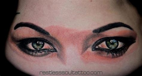 realistic eye tattoo by restless soul tattoo