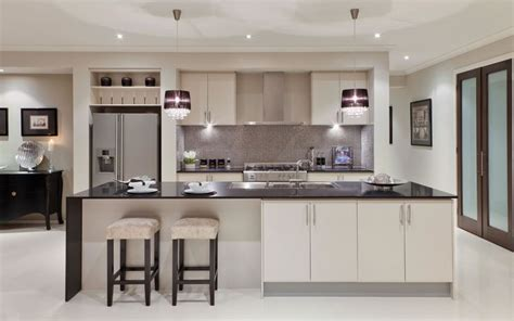 white kitchens grey bench tops grey theme silver mosaic splashback tiles white cupboards and black benchtop