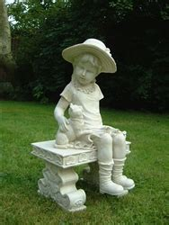 little girl sitting on bench statue girl sitting with cat on bench ornament sitting girl and