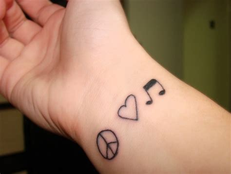 tattoo love and peace peace love music tattoo on wrist busbones