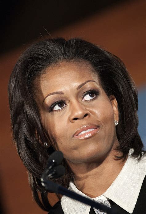 michelle obama hair michelle obama medium layered cut shoulder length